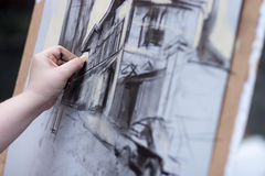 A close-up of the process of drawing a picture, which depicts t stock photography
