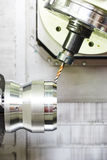 Close-up process of metal machining by drilling Royalty Free Stock Images