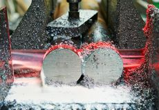 Close-up process of metal machining by saw Stock Photo