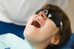 People in the dental clinic are treating their teeth stock images