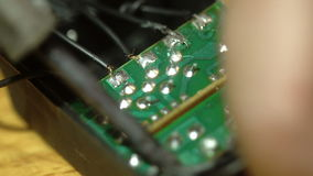 Close up of process of soldering wires to the chip stock footage