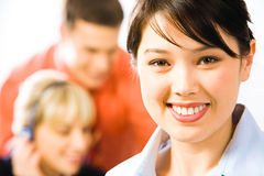 Close-up of professional. Close-up of pretty professional with charming smile on the background of people royalty free stock images