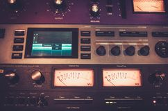 Close-up professional audio equipment with sliders and knobs at recording studio. stock photos