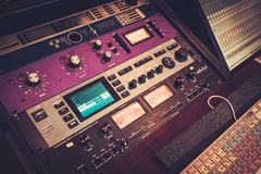 Close-up professional audio equipment with sliders and knobs at recording studio. Royalty Free Stock Photo