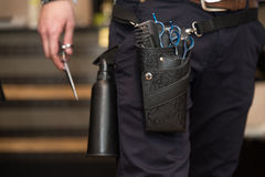 Close-Up Of Professional Equipment Tools Accessories Of Hairdres. Tools Of A Professional Hairdresser Neatly Stored In A Leather Belt And Pouch Worn Around His Royalty Free Stock Image