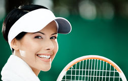 Close up of professional female tennis player. With towel on her shoulders royalty free stock photo