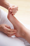 Close up of professional foot massage. In studio royalty free stock photography
