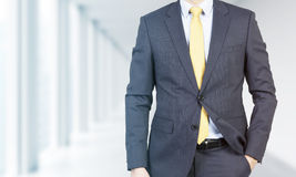 Close-up of a professional in formal suit with the hand in the pocket. Stock Photos