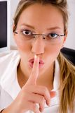 Close up of professional instructing to be silent Stock Photography
