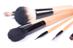 Close up of professional make-up brushes over white Stock Image