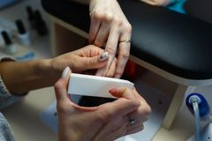 Close-up professional manicure pedicure polishing nail file clie Royalty Free Stock Images