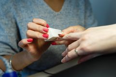 Close-up professional manicure pedicure polishing nail file clie Royalty Free Stock Photography