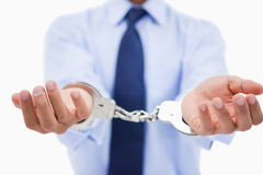 Close up of a professional's hands with handcuffs Royalty Free Stock Photo