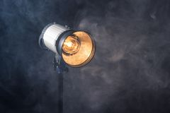 Close-up of a professional lighting fixture on a set or photographic studio. Concept of shooting a movie stock photos