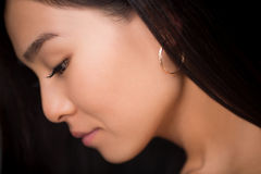 Close-up profile of asian lady in studio Stock Photo