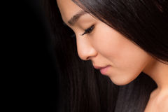 Close-up profile of asian lady in studio Stock Photos
