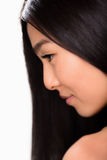Close-up profile of Asian lady in studio Royalty Free Stock Photo
