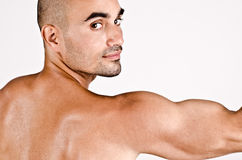 Close up on profile of a man and the arm with the shoulder and biceps. Royalty Free Stock Image