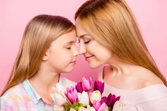 Close up profile of nice, lovely mother and daughter, nose to no royalty free stock image