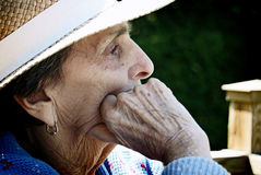 Close-up Profile of Old Woman. A close-up profile shot of an elderly, senior woman stock photography