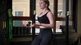 Close-up profile shot of concentrated sportsgirl running with raised knees in gym. Close-up profile shot of concentrated sportsgirl running with raised knees in stock video footage