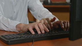 Close-up of programmer hands having a third hand typing stock video