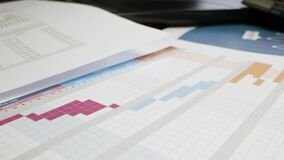 Close Up Project Management Printouts on Table. High quality