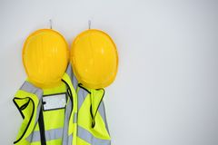 Close-up of protective workwear hanging on hook Stock Photos