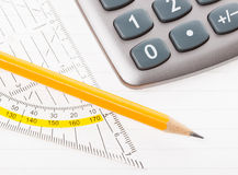 Close-up of protractor, calculator, and pencil Stock Images