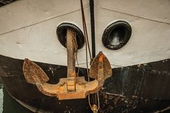 Close-up of prow and rusty anchor of a boat moored in port at Amsterdam. Famous for its huge cultural activity, graceful canals and bridges. Northern Stock Photos