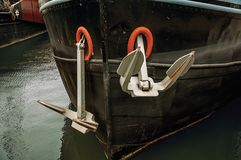 Close-up of prow and rusty anchor of a boat moored in port at Amsterdam. Famous for its huge cultural activity, graceful canals and bridges. Northern Stock Images