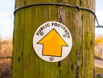 Close up of public footpath sign outside circle on wooden post. Essex; england; uk Stock Photography