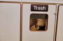 Close up of public railway trash bin. A close up of a public railway trash bin and discarded rubbish Stock Images