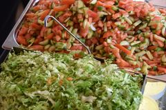 Colorful, fresh Cobb Salad. Close-up of pulled pork cobb salad assembled with arranged rows of thinly sliced red cabbage, corn, sweet pepper, cucumber and stock photos