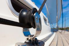 Close up pulley block on a yacht. Close up shot of a yachts block pulley and ropes while sailing Stock Image
