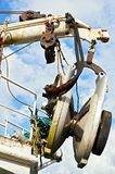 Close-up of pulley wheels with ropes on an abandoned ship stock images