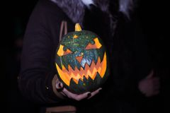 Close up.pumpkin for Halloween in the hands of the guy stock images