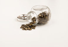 Close up of pumpkin seeds spilling out of glass jar Royalty Free Stock Image
