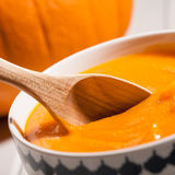 Close up of pumpkin soup in a bowl Royalty Free Stock Image