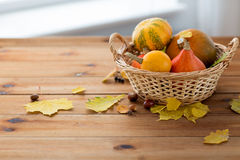 Close up of pumpkins in basket on wooden table Royalty Free Stock Images