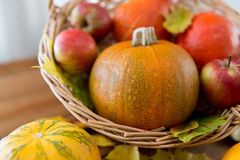 Close up of pumpkins in basket on wooden table Stock Photography