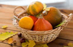 Close up of pumpkins in basket on wooden table Royalty Free Stock Photography