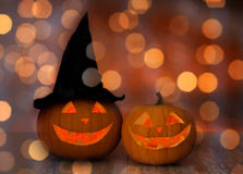 Close up of pumpkins over holiday lights background Royalty Free Stock Photos
