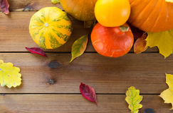 Close up of pumpkins on wooden table at home Stock Photography
