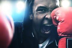 Close up of punching boxer Stock Photos