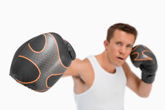 Close up of punching fist stock photos