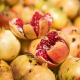 Close up punica granatum. Loose pomegranate Punica granatum available at the fruit market Royalty Free Stock Photos