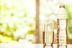 Close up the purified fresh drink water from the bottle on table Royalty Free Stock Photos