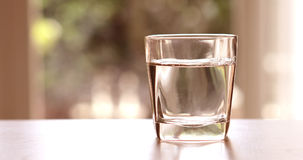 Close up the purified fresh drink water from the bottle on table Stock Images