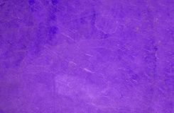 Close up of a purple coat, fur texture to background stock image